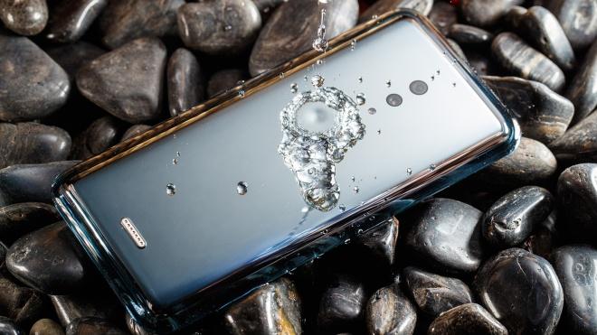 Мода на «суцільні» смартфони. Vivo представила цілковито скляний телефон без портів і з єдиним отвором