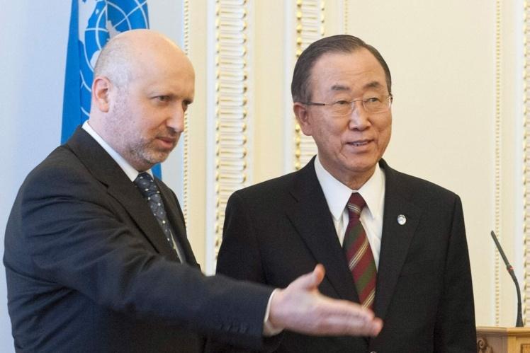 З генеральним секретарем ООН Пан Гі Муном, 21 березня 2014 року.