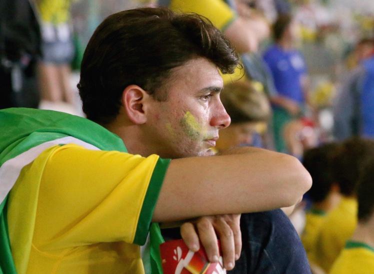 Вболівальник Бразилії на стадіоні «Мінейран» у місті Белу-Оризонті, 8 липня 2014 року.